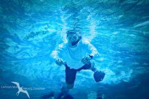 man snorkeling on a private boat charter in grand cayman