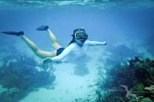 girl snorkeling on a private charter in grand cayman