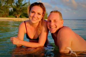 a couple in the afternoon sun on a private boat charter to starfish point grand cayman