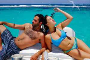 couple relaxing on our private charter boat in grand cayman