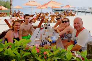 family having lunch on a private boat charter to kaibo grand cayman
