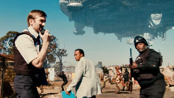 Wikus Van De Merwe (Sharlto Copley, left) and his associates (Mandla Gaduka, centre, and Kenneth Nkosi) prepare to clear out an alien slum in the South African sci-fi film District 9.