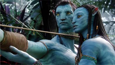 Neytiri, played by Zo Saldana, right, teaches Jake, played by Sam Worthington, the skills he'll need to survive on the planet Pandora in Avatar, the highest-grossing film of all time.