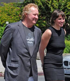 Actor Randy Quaid and his wife, Evi, are escorted from Santa Barbara County court on April 26.
