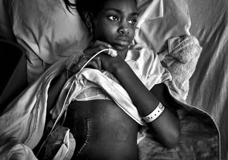 Los Angeles Times photographer Barbara Davidson won the Pulitzer for a series of images including this one of Erica Miranda, 10, who was shot three times while playing basketball outside her home in Compton, Calif.