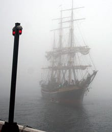 The Picton Castle rolls in through the fog for the Tall Ships Nova Scotia Festival in Halifax on Thursday.