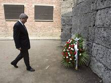 Prime Minister Stephen Harper arrives at the Wall of Death for a moment of reflection at the Auschwitz-Birkenau State Museum.