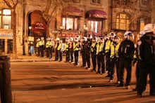 Anti-riot police line up on a Montreal street Monday night after vandals stormed the downtown area.