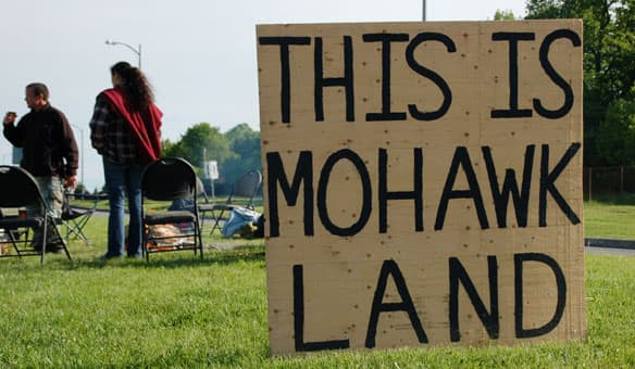 Mohawks gather near the Seaway International Bridge to protest the arming of border guards (Rebecca Zandbergen/CBC)