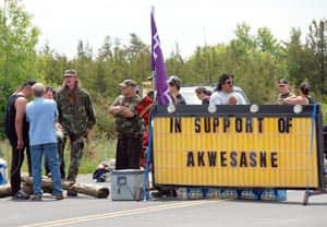 Mohawk protesters block access to the Skyway Bridge, which spans the Bay of Quinte near Belleville, Ont., and links the Tyendinaga Mohawk Territory and Prince Edward County.  (Submitted by Christopher Clarke)