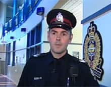 Acting Staff Sgt. Erik Johnson speaks with a CBC reporter about a series of break-ins in Millwoods on Wednesday. (CBC)