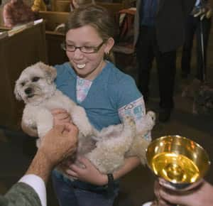 Alexa Nadeau with her dog, Christy, at a monthly service being tried at Christ's Anglican Church in Montreal.