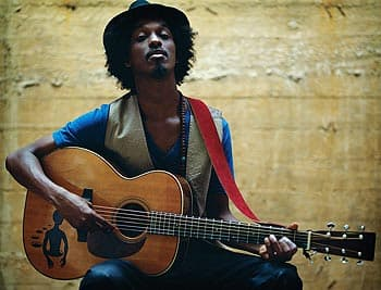 K'naan travelled to 80 countries this year as part of a World Cup promotional tour. The performer says he's tired, unhappy over a breakup and feels the urge to write new songs.