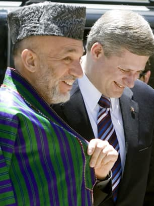 Friendlier once. Afghan President Hamid Karzai and Stephen Harper just before entering the presidential palace in Kabul in May 2007. (Tom Hanson/Canadian Press)
