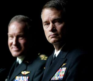 Chief of the Defence Staff Gen. Walt Natynczyk, left, holds a joint press conference with United States Admiral James Winnefeld at National Defence headquarters in Ottawa on Monday.