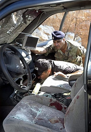 Lebanese officials inspect the aftermath of an attempt on the life of Lt.-Col. Samer Shedaheh, Eid's boss at the ISF. Shedaheh survived the car bomb attack, near Sidon, in September 2006 and was sent to Canada for treatment and resettlement. (Kamel Jabe/Reuters)