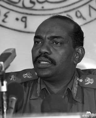Gen. Omar al-Bashir announces he will lead a new 21-man cabinet in Khartoum on July 9, 1989. Al-Bashir had just become military ruler after leading a coup.