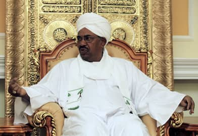 Sudanese President Omar al-Bashir reacts during a meeting in Khartoum on April 20, 2010. The week before, al-Bashir won the first contested presidential election since 1986, after boycotts left little opposition.