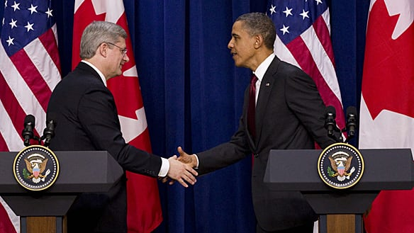 Prime Minister Stephen Harper and President Barack Obama shake hands at a joint news conference in the Eisenhower Executive Office Building after their meeting at the White House Friday.