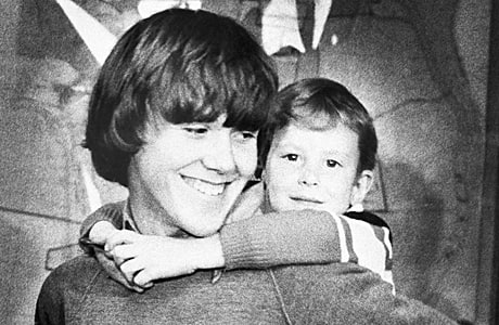In this March 2, 1980, file photo, Timothy Lee White gets a piggy back ride from Steven Stayner at a news conference in Ukiah, Calif.
