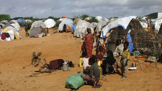 Children play outside their makeshift shelters in a refugee camp in Mogadishu, Somalia, on Thursday. Witnesses say troops opened fire on famine refugees Friday as food was being distributed.