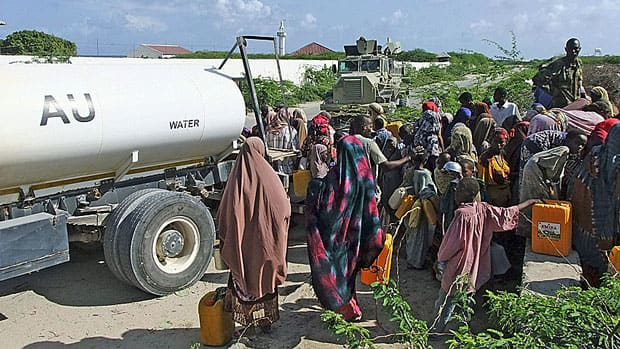 African Union peacekeepers distribute water to internally displaced people in Mogadishu, Somalia. Developing countries contribute most to the world's population growth, and will need a lot more water to feed new mouths.