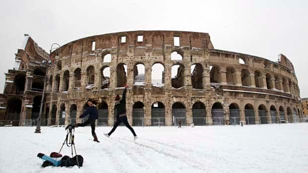 Two girls from the Philippines take a self-timer photo in front of the Colosseum on Saturday.