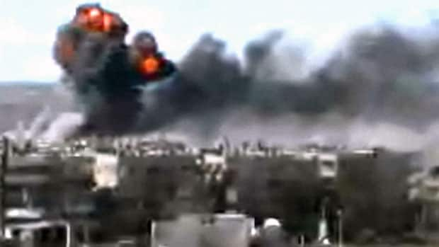 This image taken from amateur video and broadcast by Bambuser/Homslive shows a series of devastating explosions rocking the central Syrian city of Homs, Syria on Monday. AP is unable to independently verify the authenticity, content, location or date of this image.