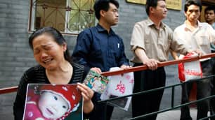 Zheng Shuzhen holds a photo of her year-old granddaughter Zhou Mengxin outside a Health Ministry office in Beijing in 2008 after tainted milk left six children dead and sickened 300,000. Two people were executed as a result.