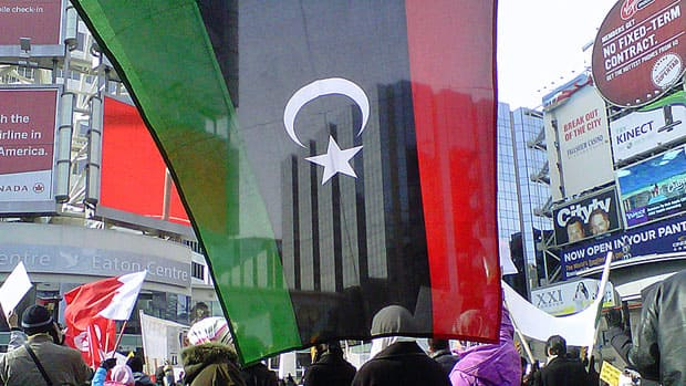 About 350 people supporting anti-government protests in Libya rally at Toronto's Yonge-Dundas Square on Sunday.