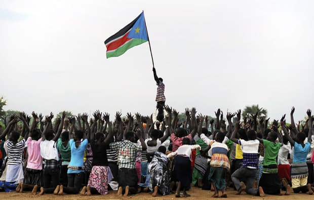 South Sudan formally declares its independence for Sudan on July 9. A man holds up South Sudan's new flag during a rehearsal in Juba July 7 for independence celebrations.