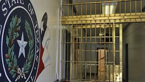 The Texas Dept. of Criminal Justice Central Unit seal is painted on the cell block wall in Sugar Land, Texas. The 102-year-old jail is slated for development as Texas reducing its prison population.