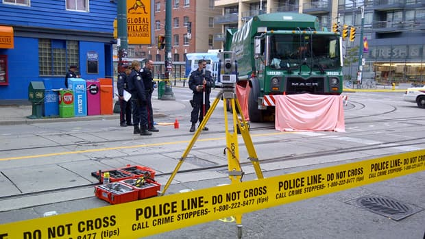 A pedestrian died after being struck by a garbage truck at the corner of King Street and Spadina Avenue early Friday.