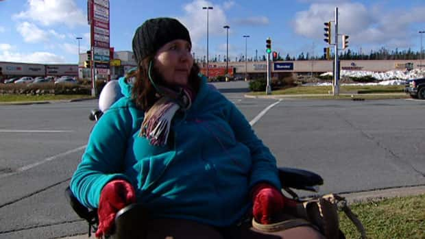 Mary MacDonald, who uses a wheelchair, says it's a huge inconvenience that the No.52 bus no longer cuts through the main parking lot of the shops in Bayers Lake Business Park.