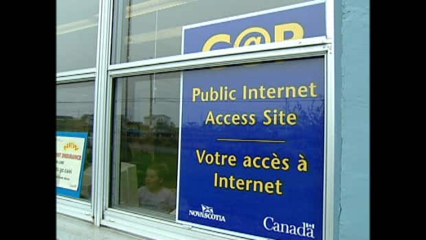 A sign in a  window reads: Public internet access site Canada
