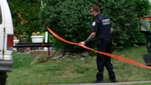 Police remained at the crime scene Friday to search for evidence in the triple homicide.
