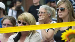 Residents of Elliot Lake listen to Ontario Premier Dalton McGuinty speak regarding recovery efforts at Algo Centre Mall on Wednesday. McGuinty has promised a full review.