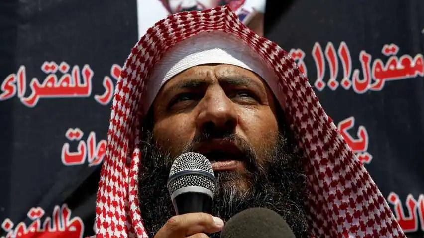 Mohammad al-Shalabi, better known as Abu Sayyaf, a Jordanian militant leader linked to al-Qaida, addresses supporters outside the Prime Minister's office in Amman, Jordan, Sept. 9 2012.