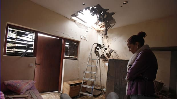 Tami Shadadi surveys the damage to her house in the southern town of Sderot on Monday, a day after it was hit by a rocket fired by Palestinian militants in Gaza.