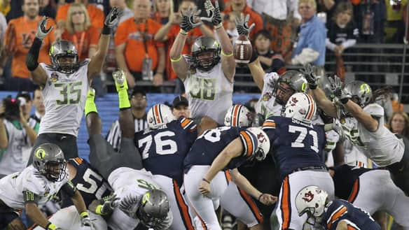 Auburn's Wes Byrum (18) kicks the game-winning field goal late in the second half of the BCS National Championship NCAA college football game against Oregon on Monday in Glendale, Ariz. Auburn won 22-19.