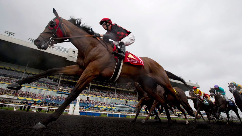 Jesse Campbell rides Midnight Aria on his way to winning the 154th Queen's Plate at Woodbine Racetrack in Toronto on Sunday.