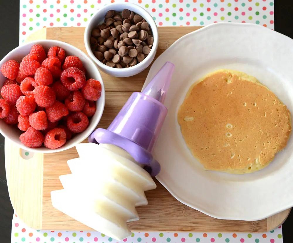 Raspberries, chocolate chips, whipped cream and one pancake.