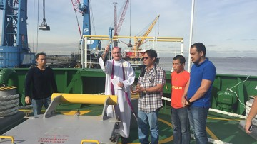 Bishop of Nottingham celebrates Mass with seafarers on board ship