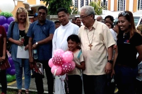 Archbishop Rolando Tria Tirona of Nueva Caceres (second from right) and Father Edwin Gariguez, head of Caritas-Philippines, lead the opening of the general assembly of Catholic social action workers in the country. (Photo by Elmer Recuerdo)