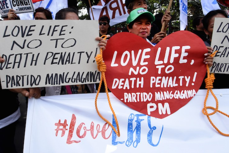 UCAN photo: Human rights advocates hold a ralyy outside the south gate of the House of Representatives in Quezon City on Valentine's Day.