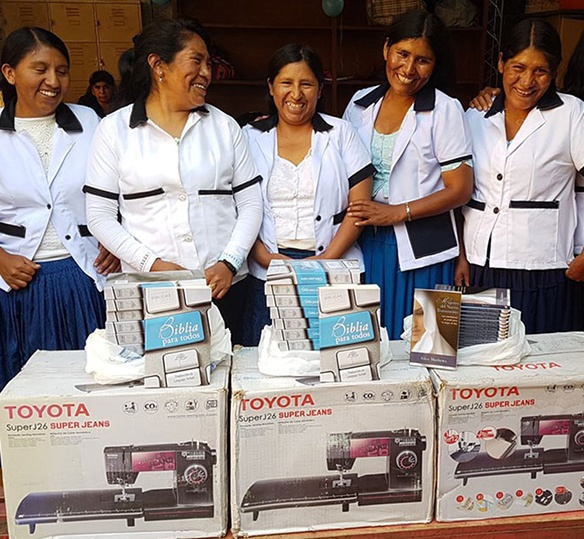 Photo of Bolivian women smiling with new sewing machines