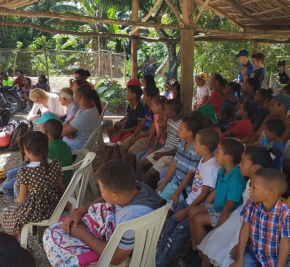 Photo of Dominican children sitting and watching a service