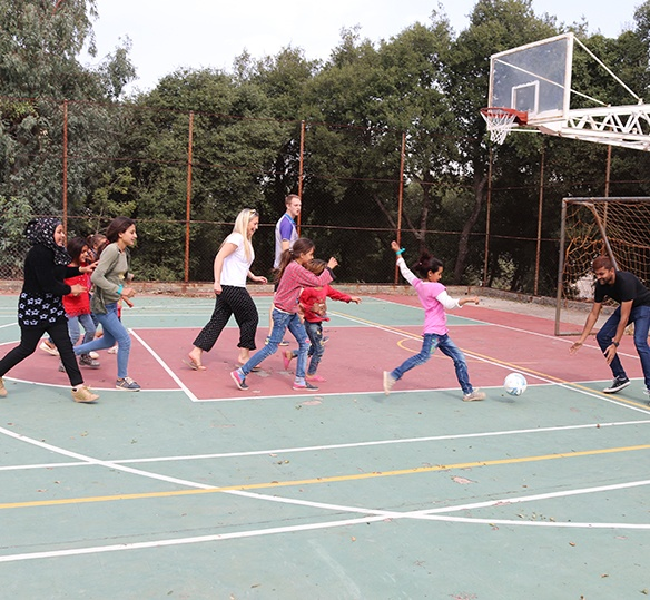 photo of Lebanese children and adults playing soccer