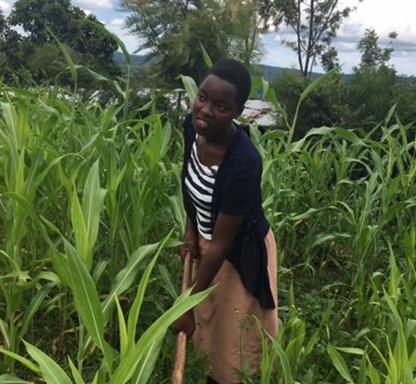Photo of a Rwandan woman in a crop field