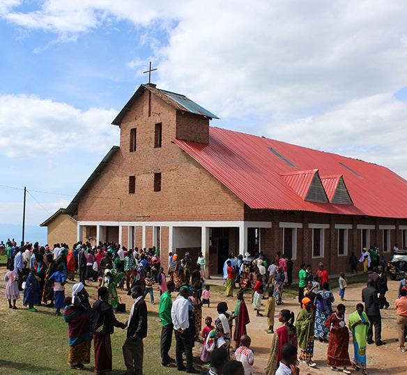 Photo of African people outside of a church